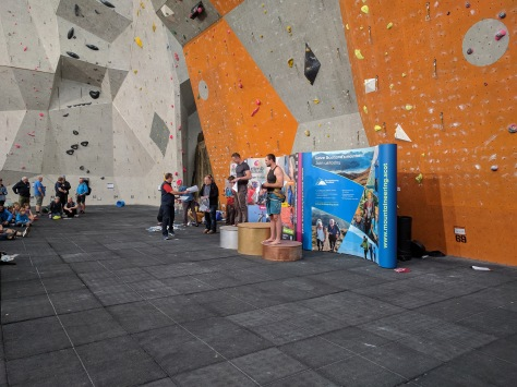 A picture of Jesse on the podium at Ratho, an indoor climbing wall in Edinburgh, Scotland. This was his first climbing competition