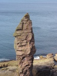 A picture of the old man of stoer sea stack in scotland. A large pillar of rock rising out of the sea.