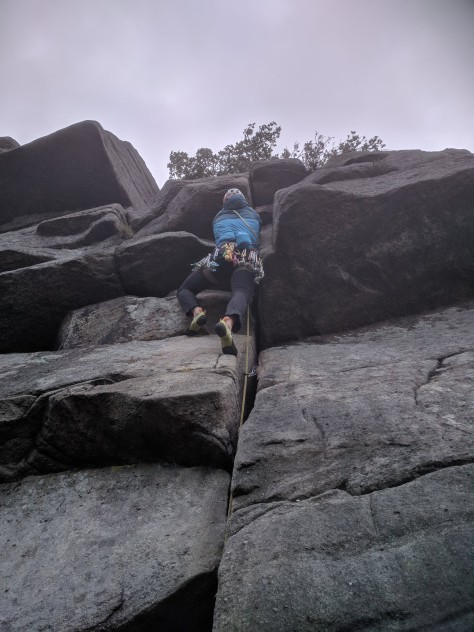 A picture of Jesse climbing Mutiny crack at Burbage North