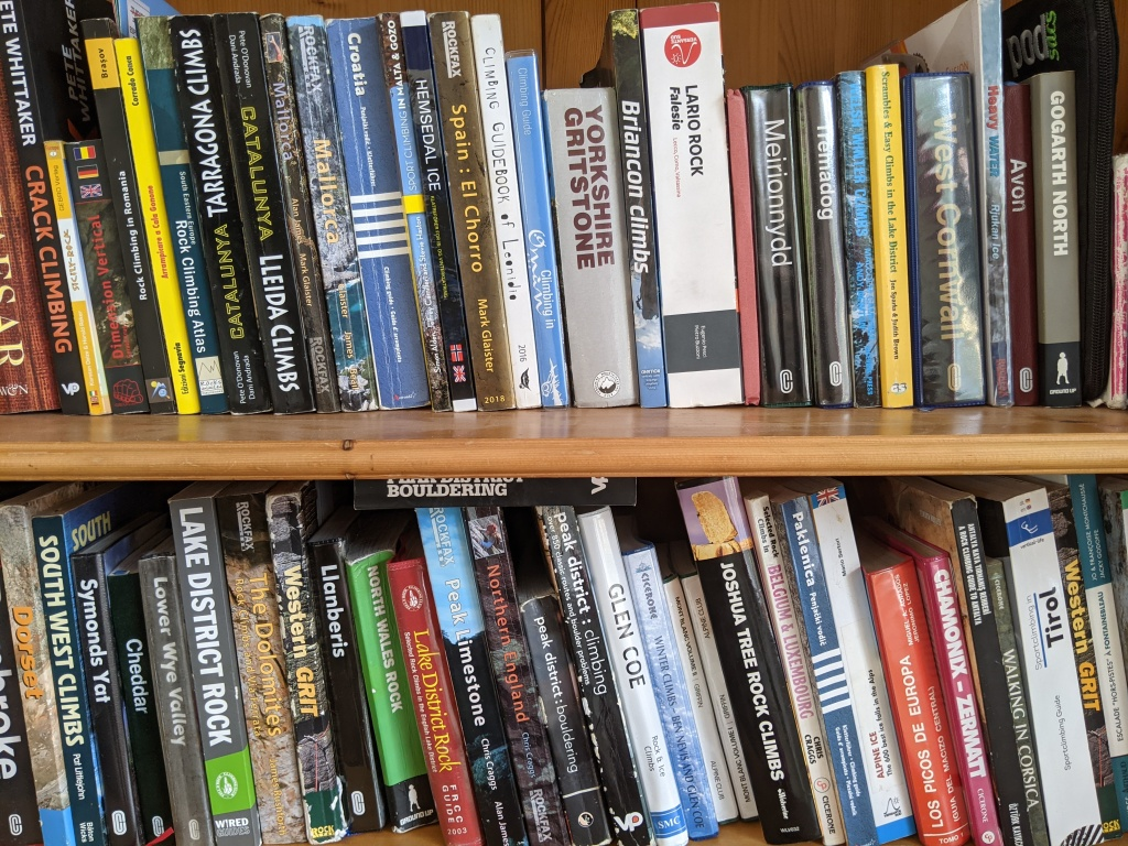 A photo of Molly and Jesse's book shelf which has many many climbing guide books on. For climbing all over the world including Romania, Spain, Italy, Norway, Oman, Malta, USA...the list goes on.