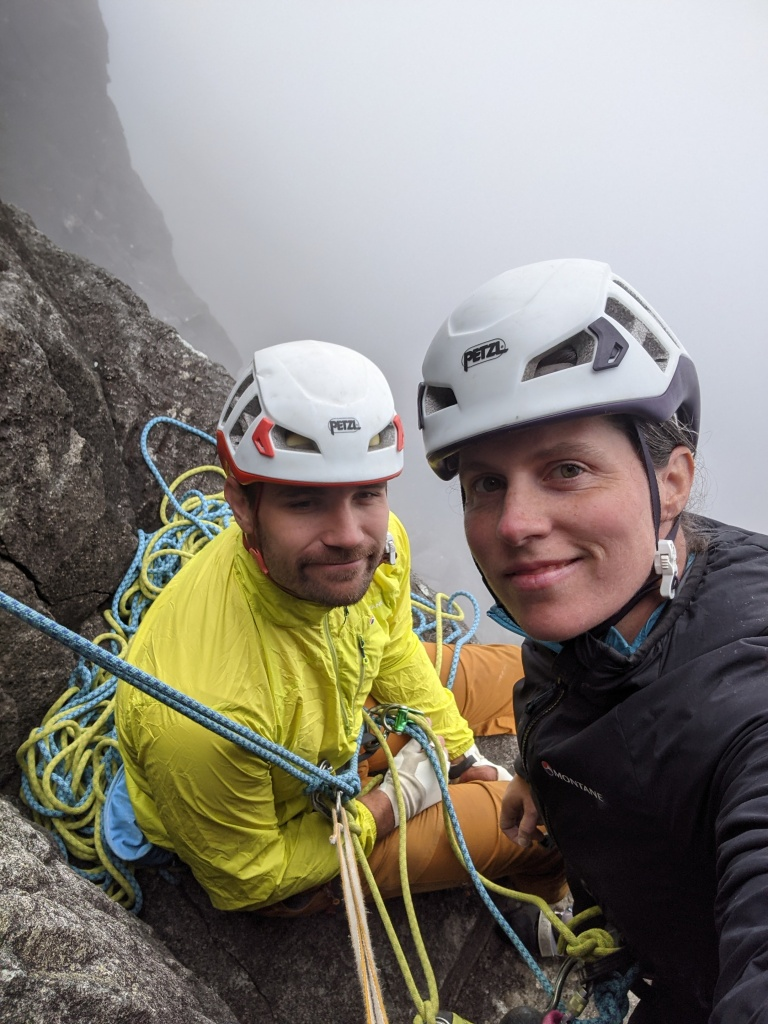 A photo of Molly and Jesse on the first belay ledge on Vulcan Wall, in the clouds a few days later.
